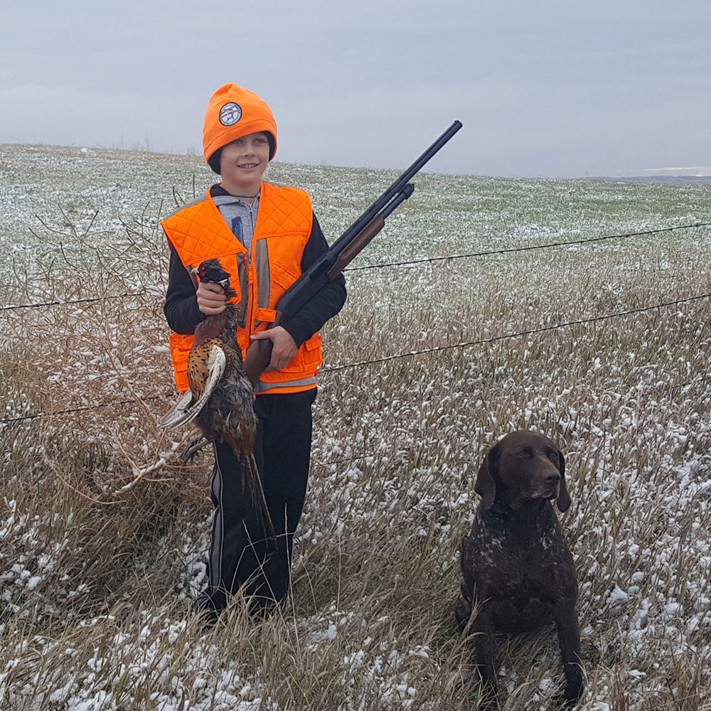 Youth with harvested pheasant