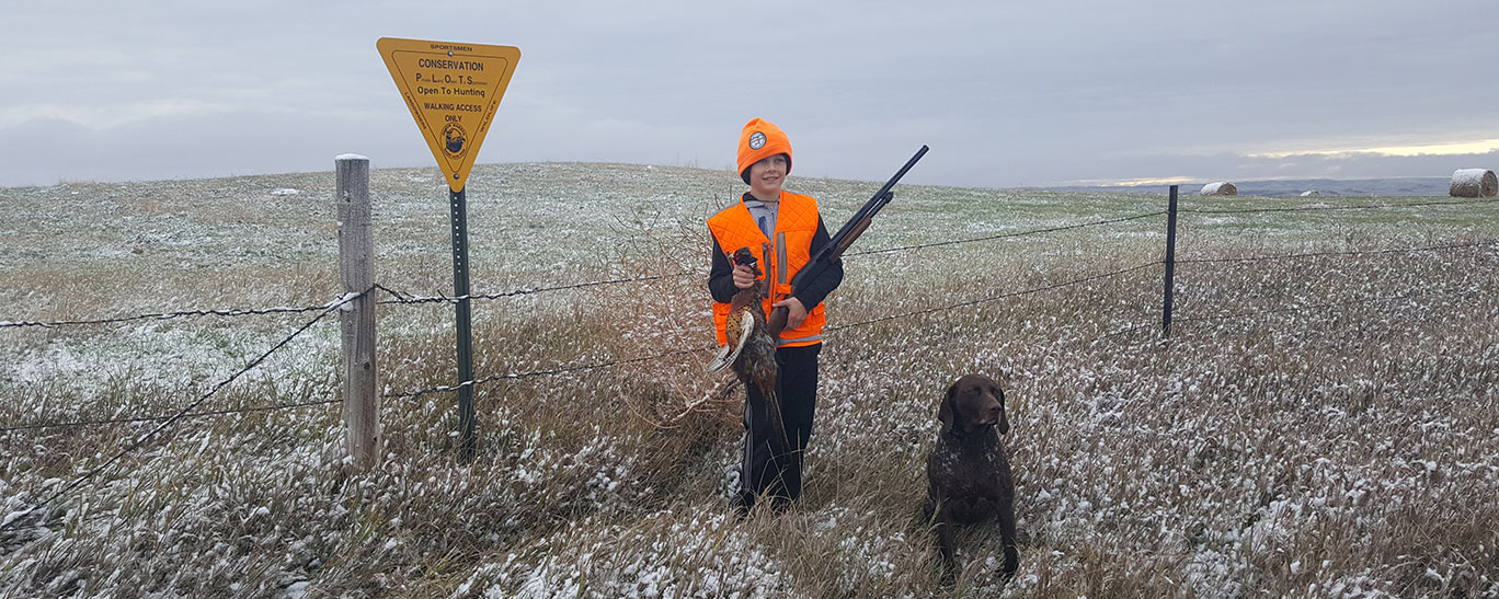 PLOTS sign and hunter with dog
