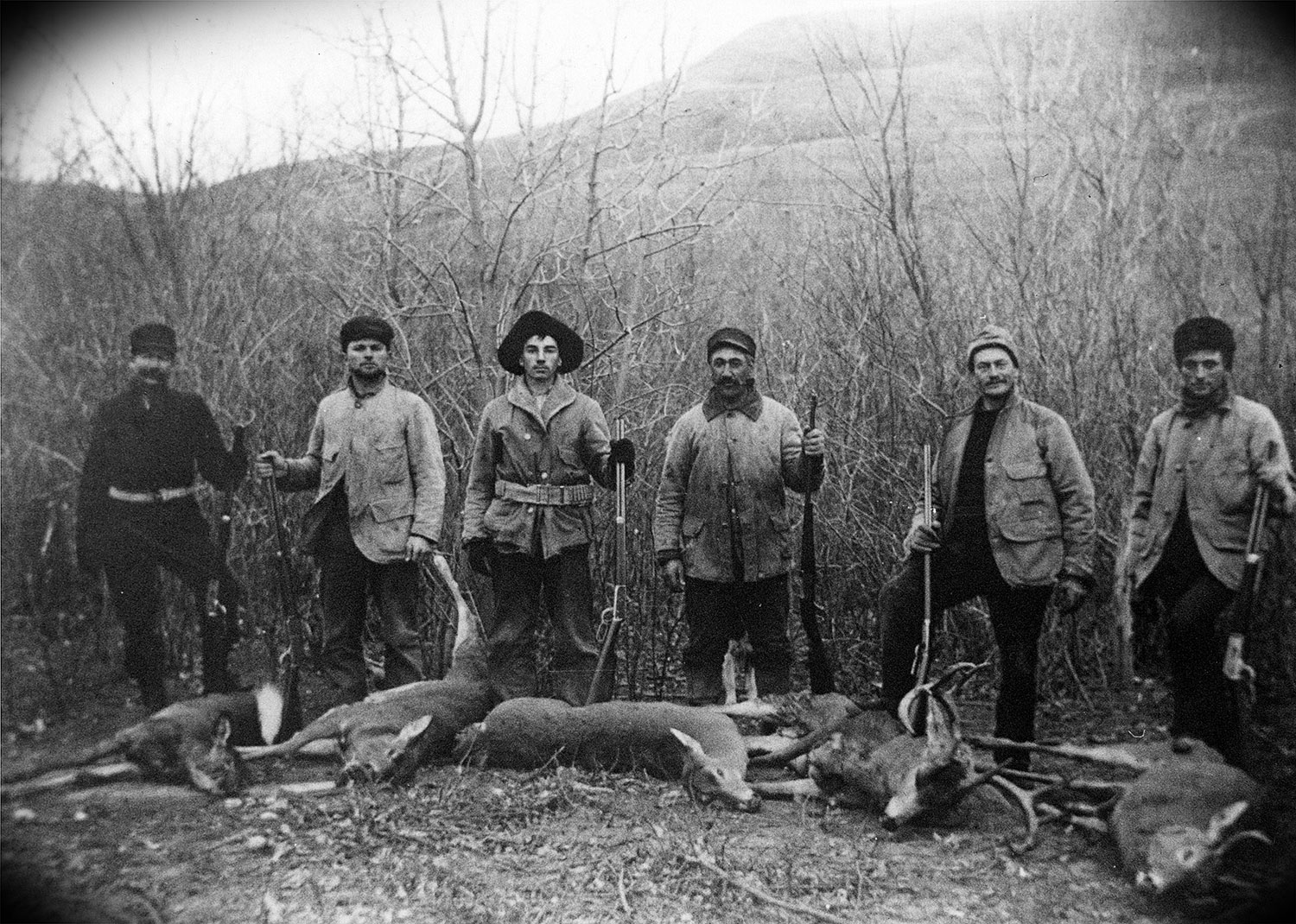 Hunters with deer