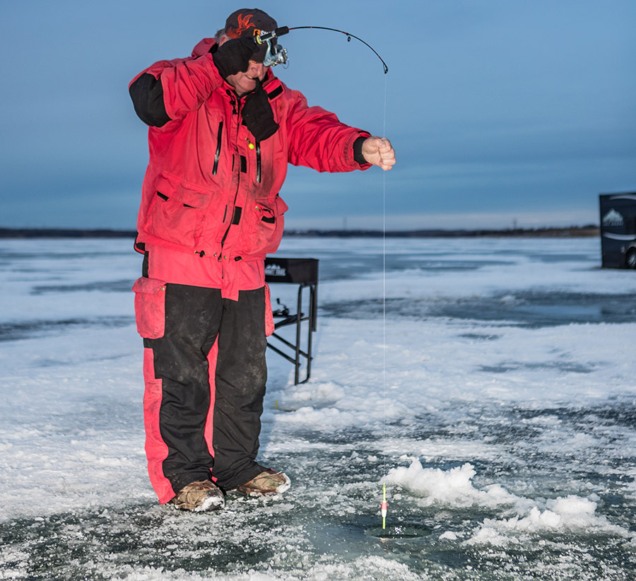 Man icefishing
