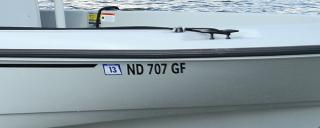 Registration numbers on boat