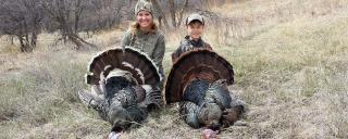 Mom and son with turkeys