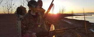Girl with Father Waterfowl Hunting