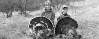 Mother and son after successful spring turkey hunt