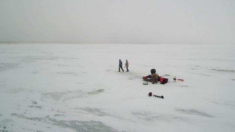 Anglers taking down ice house