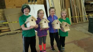 Kids with bird boxes